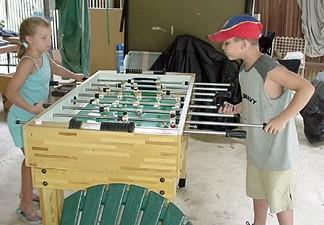 Robby and Megan playing Foosball at the river