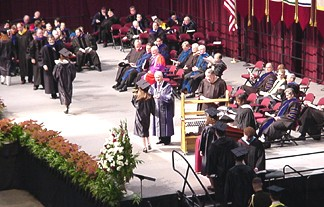 Kelly receiving her diploma
