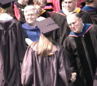 Kelly Shaking hands with some honcho... Probably the Dean of Mathematics