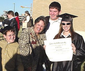 Kelly with her Mom and brothers... L-R: Ryan, Debbie, Mark and Kelly