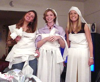 The three models - the contest was to see which group could dress their model better using only rolls of toilet paper!