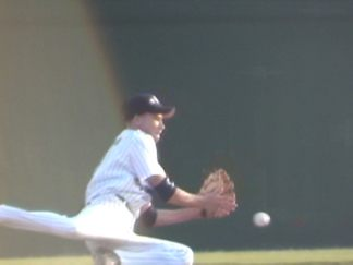 (1 of 4) Ricky Watkins at short makes the play behind 2nd and trys to complete to Patrick Griffin covering the bag
