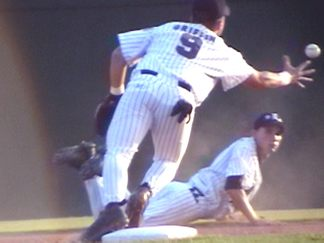 (3 of 4) Ricky Watkins at short makes the play behind 2nd and trys to complete to Patrick Griffin covering the bag