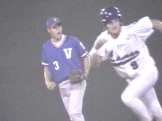 Patrick Griffin going to third with a Matocha in the background (the Victoria Shortstop)