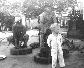 1948 - We fix tires too! Rudy Dluhy, Joe Stryk and Michael Stryk supervising the whole operation