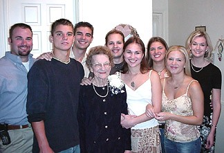 Mom with her grandkids.... L-R Wade, Patrick, Shaun, Aaron, Nicole, Natalie, Susannah, Leah.  (Only Tini and Lance are missing)