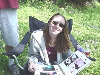 Kelly is looking at Johnathan and Amy's picture album. Hannah is the star of this book!