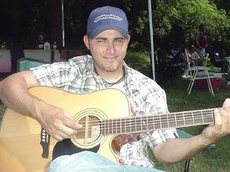 David playing the guitar