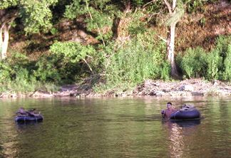 Chase and Patrick floating the wood back to our campsite