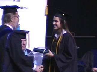 Nicole receiving her diploma