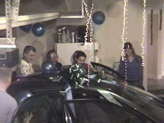A car in the garage filled with baloons - a surprise from Joanie, Chandra, Mike and Roger