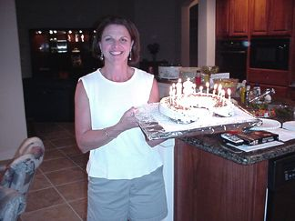 Joanie bringing in Patrick's Birthday Cake with 18 candles blazing!