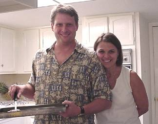 Roger and Joanie - cooking burgers for the party