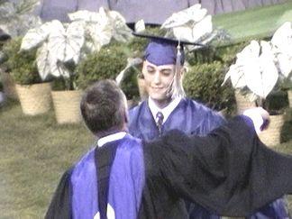 Craig Elliott being congratulated by the principal - Walt Wendtland