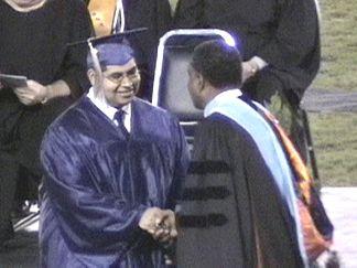Mario Lopez getting his diploma