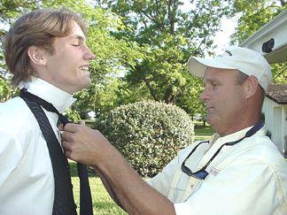 Glenn Nelson helping Daniel Steinhaus with his tie