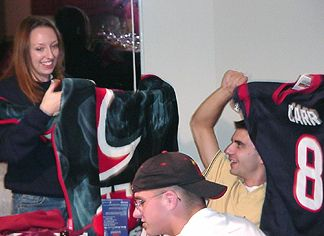 Kelly with her Texan's blanket and Shaun with a David Carr Jersey