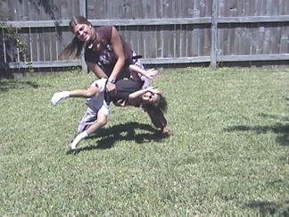 Natalie teaching Suzannah how to do a cartwheel