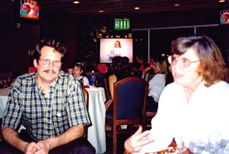 Roger's brother and Sister-in-law... Hank and Alice (In the background on the Big Screen TV is a 7 year old Kelly holding her baby brother Mark