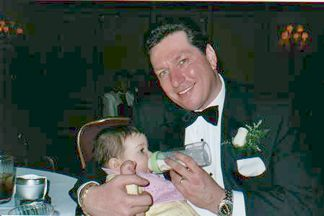 Kelly's Dad - Joe Heisler - feeding his little baby