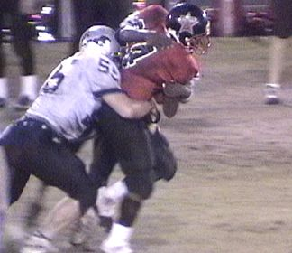 Robbie Balena (and someone else) makes the tackle