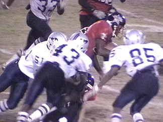 Robert Acosta, Shawn Davis and Joecoli Jackson closing in on the tackle