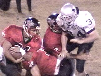 BJ Hurley closing in for the tackle