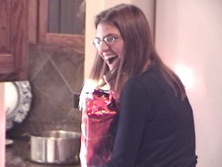 Natalie got caught sneaking a peek as one of the gifts *(Well..... sort of)