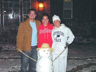 Natalie Nicole and Patrick building a snowman