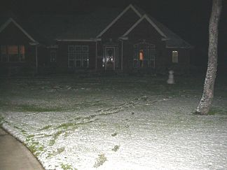 Santa coming up the Driveway at 5:30am on Christmas Morning.... Looks like the snowman made it through the night