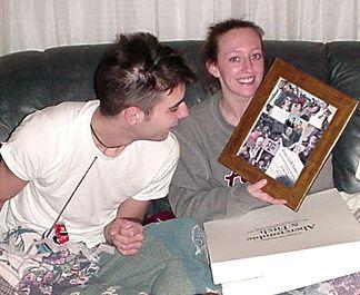 Shaun looking at Kelly's graduation photo collage